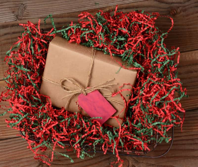 http://www.dreamstime.com/stock-image-christmas-present-crepe-paper-high-angle-view-wrapped-eco-friendly-craft-tied-twine-package-resting-image39240211