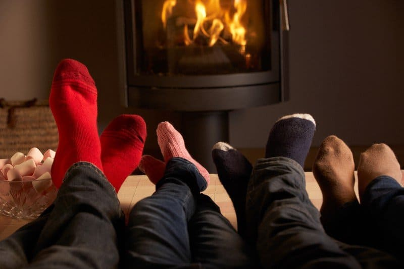 http://www.dreamstime.com/royalty-free-stock-image-family-s-feet-relaxing-cosy-log-fire-image25642826