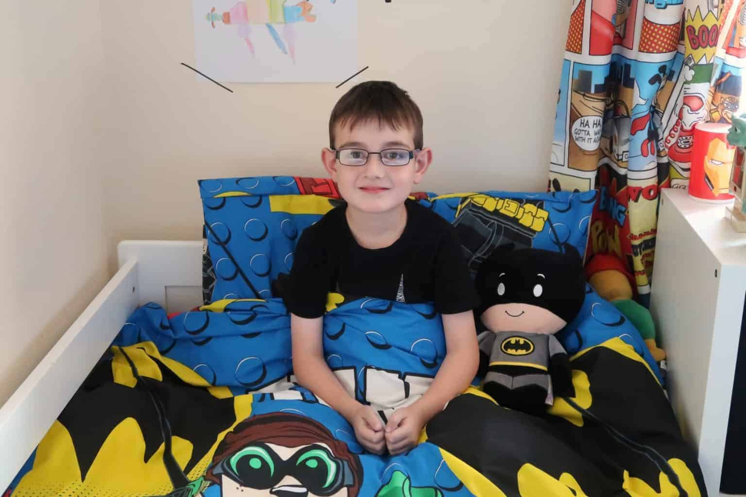 Adding the finishing touches to a Batman Inspired Bedroom
