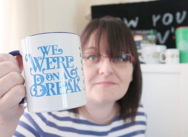 Woman holding a Friends 'We were on a break' mug