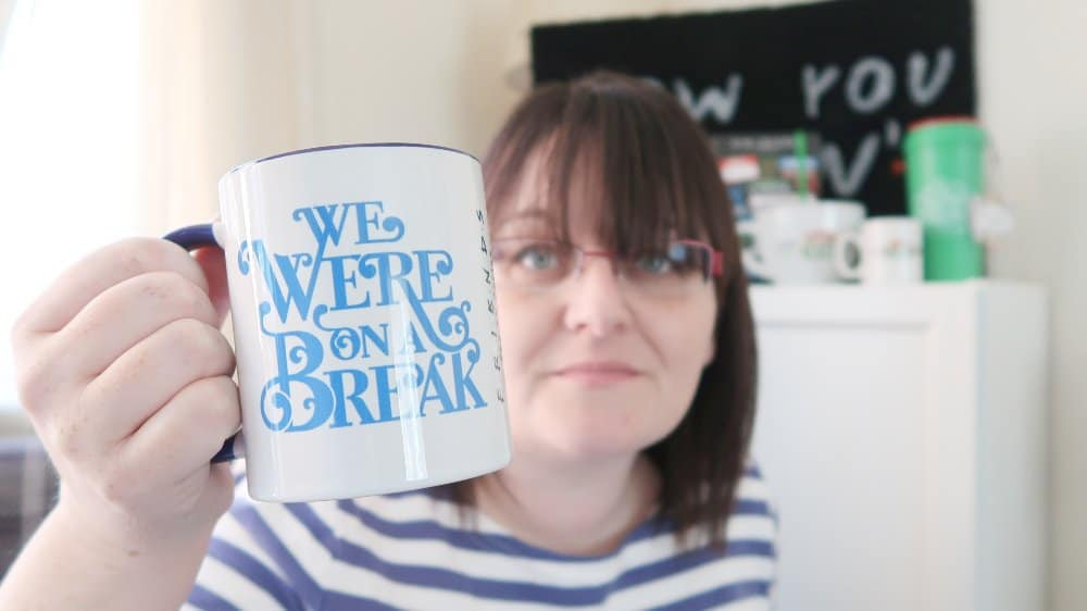 Woman holding a Friends 'We were on a break' mug