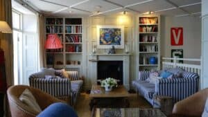 home with fireplace, bookcases and sofas