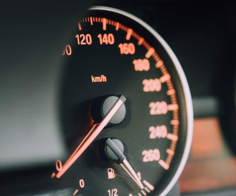 Car dashboard with black and red dials