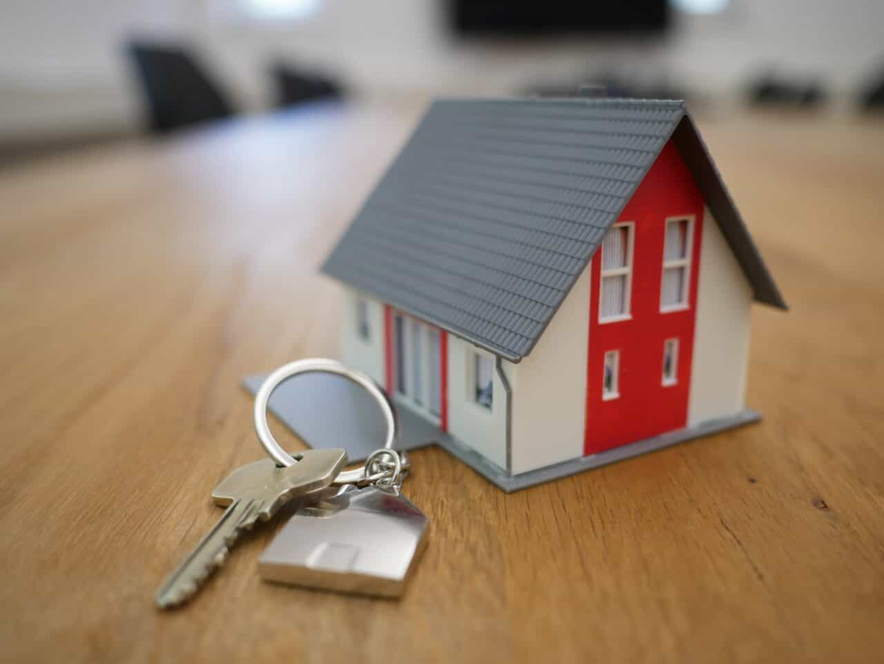 white and red wooden house with keys