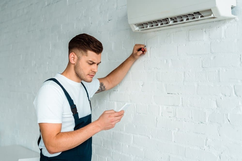 air conditioner unit with workman
