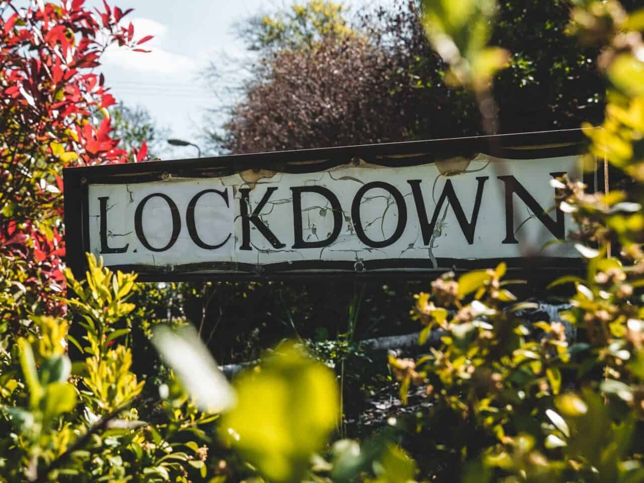 lockdown street sign with foliage