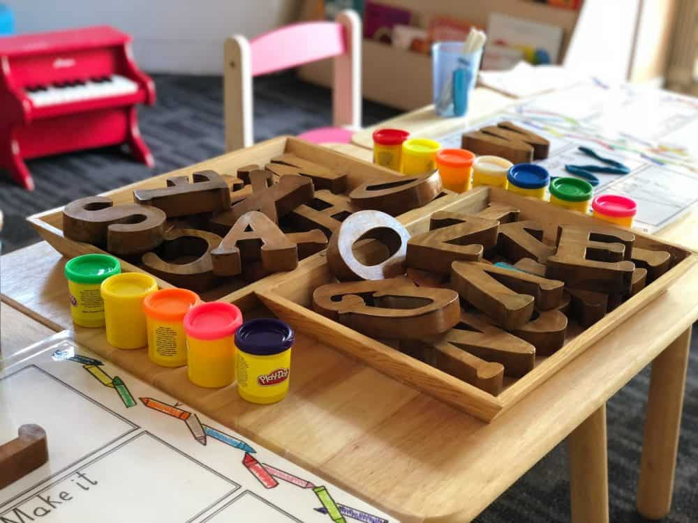 brown wooden letters on a child's desk