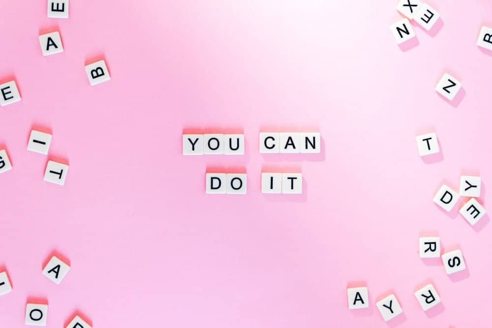 You Can Do It text tiles on a pink background