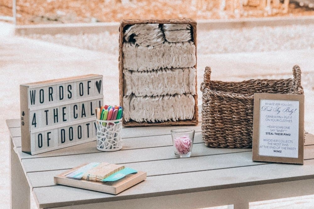 brown wicker basket on a wooden table for a baby shower