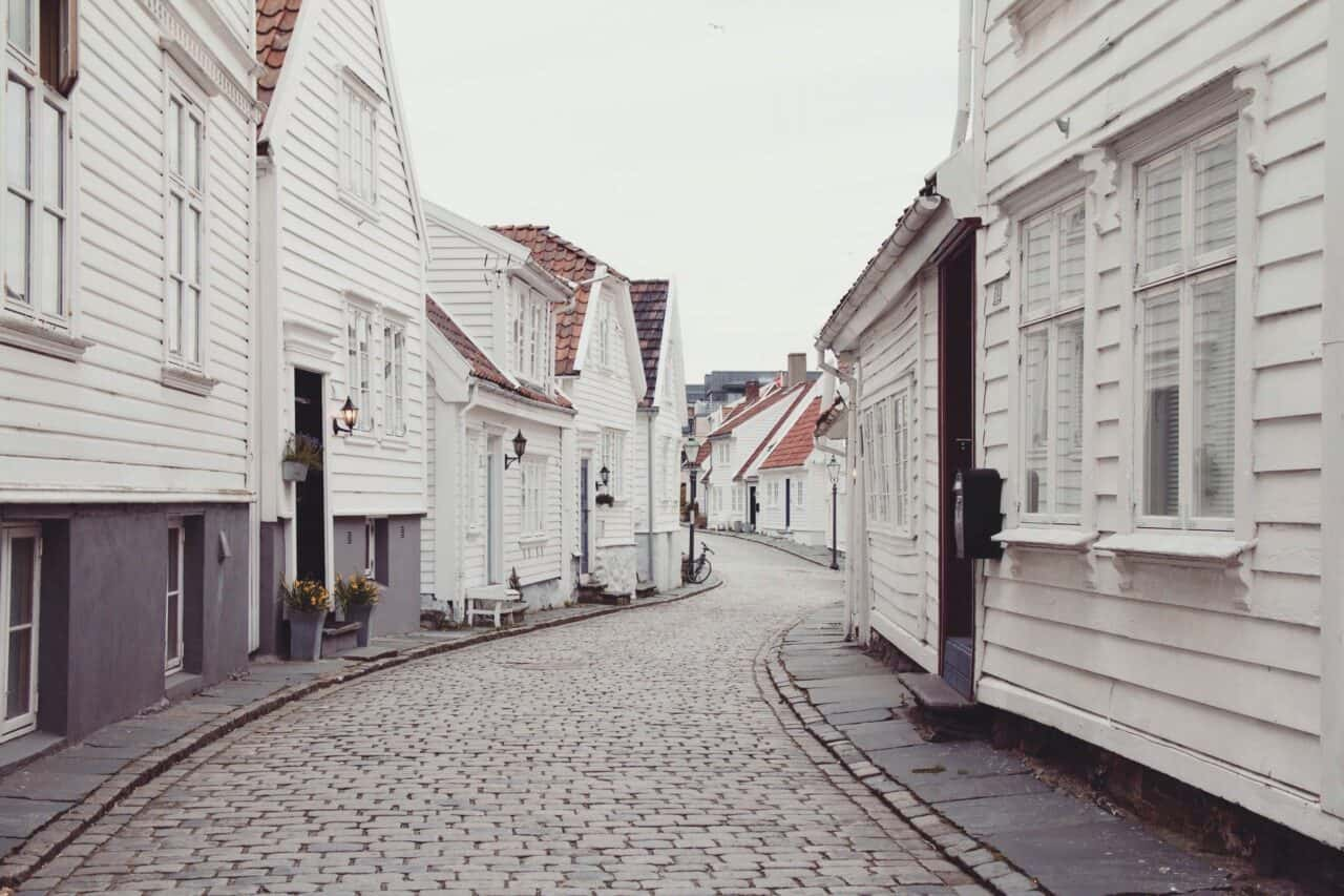 empty roadway between white houses