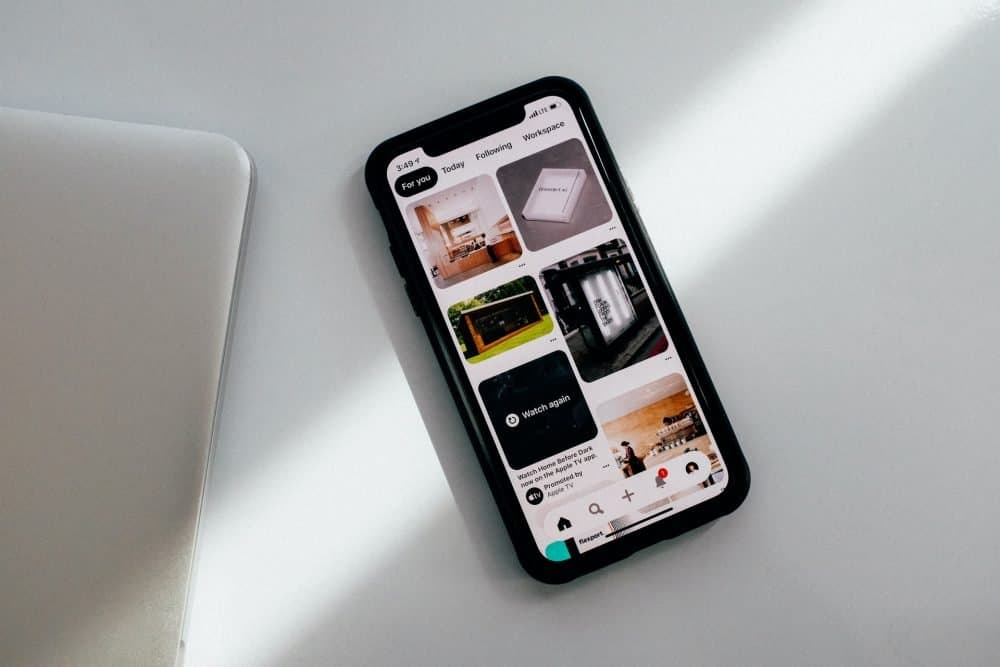 black iPhone featuring Pinterest pin images
