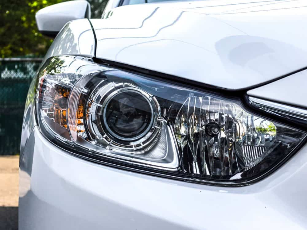 Closeup of the LED light of a white Mazda