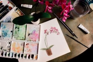 white pink and green floral artwork with art palette