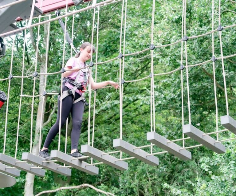 teenager completing a high ropes course